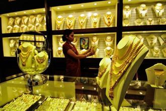 Gold prices fell Rs 235 today, after rising Rs 350 on Thursday.