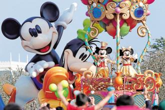 Mickey exists in all of Disney's verticals, including television, gaming and theme parks, but its popularity is most visible in consumer products. Photo: Bloomberg