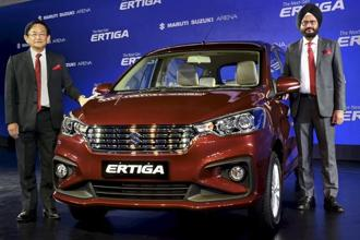 Maruti Suzuki CEO Kenichi Ayukawa and senior executive director R.S. Kalsi with the new Ertiga in New Delhi on Wednesday. Photo: PTI