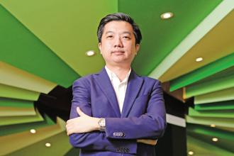 William Tanuwijaya has cited his first meeting with SoftBank's billionaire founder Masayoshi Son as a turning point for Tokopedia. Photo: Bloomberg