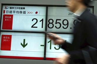 The yield on benchmark Japanese 10-year bonds fell to the lowest since July. Photo: AP