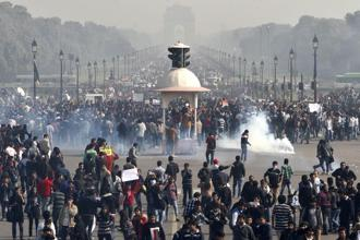 Police use water canon and tear gas to control demonstrators during a protest at Vijay Chowk, following a brutal gang rape of a 23-year-old student in New Delhi on 22 December 2012. Photo: Hindustan Times
