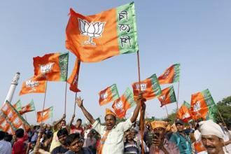 BJP supporters with the party flags in Kolkata. File photo: Reuters