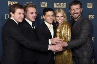 "Joseph Mazzello, from left, Ben Hardy, Rami Malek, Lucy Boynton and Gwilym Lee, winners of the award for best motion picture, drama for ""Bohemian Rhapsody"" as they arrive at the Fox afterparty at the Beverly Hilton Hotel on Sunday. Photo: AP"