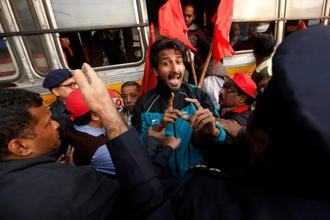 Left supporters were detained by police during an anti-government protest rally, organised as part of two day nationwide strike by various trade unions in Kolkata. Photo: ReutersPhoto: Reuters