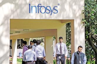 Infosys shares closed at Rs 669.85, down 0.19%, or 1.30 points, on the BSE on Tuesday. Photo: Bloomberg
