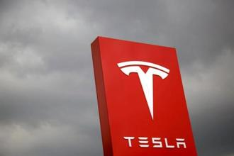 Tesla is offering cybersecurity researchers the chance to walk away with an electric Model 3 sedan if they can hack into the car and find vulnerabilities. Photo: Reuters