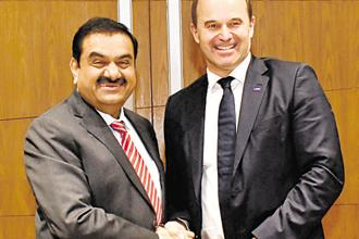 Adani Group chairman Gautam Adani with BASF's Martin Brudermuller. BASF SE will hold the majority in the joint venture, which will  invest in the 'acrylics value chain'.