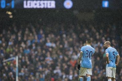 Manchester City's Pablo Zabaleta (right) and Nicolas Otamendi stand on the pitch during the English Premier League soccer match between Manchester City and Leicester City at the Etihad Stadium in Manchester. Photo: AP