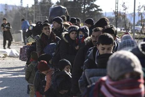 Migrants line up as they wait to cross the borderline with Macedonia from the northern Greek village of Idomeni. In an EU summit next week, leaders will again discuss how to resolve a crisis that has set them against each other. Photo: AP