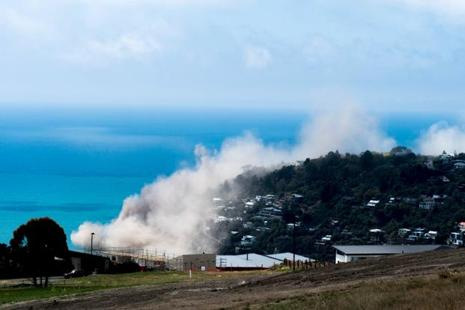 The Christchurch City council said cliffs collapsed in several places along the surrounding coast, spreading large clouds of billowing dust across the sea and hills. Photo: Reuters
