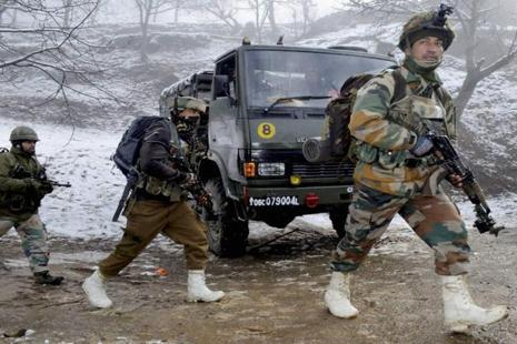 Army personnels taking positions outside the house where LeT commander Abu Usama was holed up during an encounter at Lolab in Kupwara on Saturday. Photo: PTI