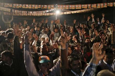 BJP supporters cheer as Sanjeev Balyan, a federal agriculture minister and a member of BJP, addresses a by-election campaign rally in Muzaffarnagar on  9 February 2016. Photo: Reuters