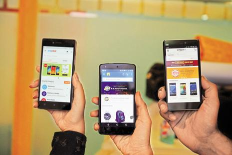 Flipkart, Amazon and Snapdeal are in the process of devising new ways to fund discounts and advertise sales. Photo: Pradeep Gaur/Mint
