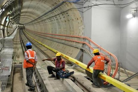 A file photo shows Metro Rail employees carrying out inspection work near a tunnel. Photo: AFP