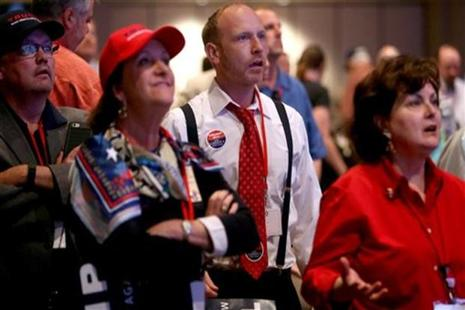 Stunned Trump supporters watch the vote results displayed at the Republican State Convention in Arizona. Photo: AP