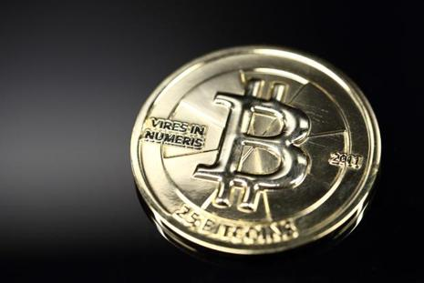 The virtual currency was unleashed anonymously in 2009. Its libertarian roots, with no central issuing authority and a public ledger to verify transactions, has become more mainstream with its adoption by merchants around the world. Photo: Bloomberg