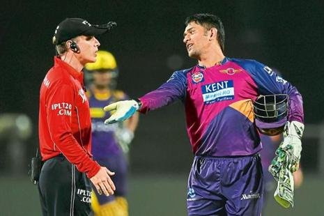 Dhoni talking to the umpire during an IPL match in Pune on 24 April. Photo: Indranil Mukherjee/AFP