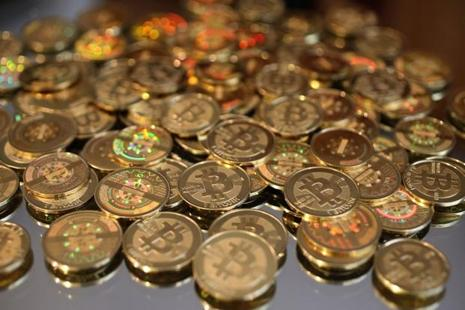 A pile of Bitcoins are shown here after Software engineer Mike Caldwell minted them in his shop. Photo: George Frey/AFP