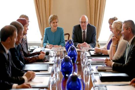 Scotland's first minister and leader of the Scottish National Party (SNP), Nicola Sturgeon (5L), chairs an emergency Cabinet meeting at Bute House in Edinburgh, Scotland on 25 June 2016, following the pro-Brexit result of the UK's EU referendum vote. Photo: AFP