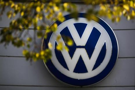 The VW sign of Germany's Volkswagen car company is displayed at the building of a company's retailer in Berlin. Photo: Markus Schreiber/AP