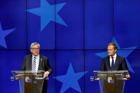 European Commission President Jean-Claude Juncker and European Council President Donald Tusk (R) address a joint news conference on the second day of the EU Summit in Brussels, Belgium. Photo: Francois Lenoir/Reuters