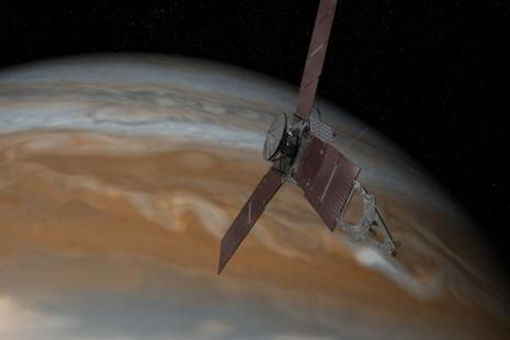 This artist's rendering provided by NASA and JPL-Caltech shows the Juno spacecraft above the planet Jupiter. Photo: AP