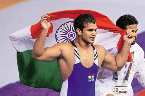 A file photo of Narsingh Pancham Yadav celebrating after winning gold in the men's 74kg wrestling in Delhi 2010 Commonwealth Games. Photo: Getty Images