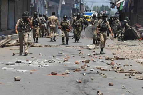 Indian soldiers patrol after clashes in Srinagar on 23 July. Photo: AFP