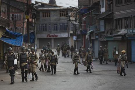 Paramilitary soldiers during curfew hours in Srinagar on Sunday. Photo: AP