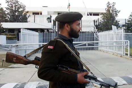 A Pakistani soldier stands guard in front of the Indian High Commission in Islamabad. Photo: Reuters