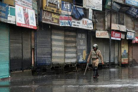 A security jawan during curfew in Srinagar on Wednesday. Photo: PTI