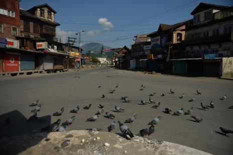 A deserted road in Srinagar on Friday. Photo: AFP