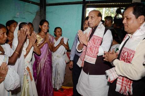 Home minister Rajnath Singh along with Assam chief minister Sarbananda Sonowal and visit flood-affected people at a relief camp in Morigaon district of Assam on Saturday. Photo: PTI