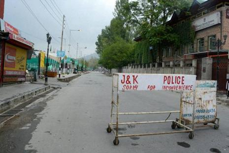 Police puts barricades at Lal Chowk during curfew in Jammu and Kashmir on Thursday. Photo: PTI