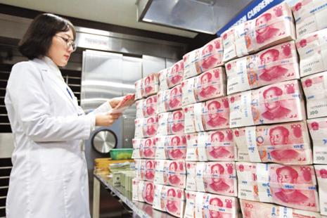 China's exchange rate fell as much as 0.24% as a gauge of dollar strength extended gains. Photo: Bloomberg