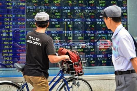 Japan's Nikkei stock index was flat after earlier wavering between positive and negative territory, as the yen pulled further away from its overnight lows. Photo: AFP