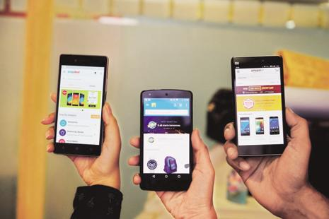 Firms are launching apps for phones low on storage and take longer to run apps. Photo: Pradeep Gaur/Mint
