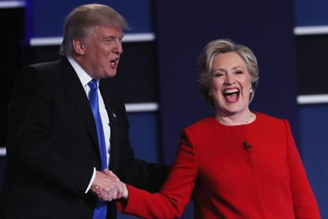 (L-R) Republican presidential nominee Donald Trump and Democratic presidential nominee Hillary Clinton shake hands after the Presidential Debate at Hofstra University on 26 September in Hempstead, New York. Photo: AFP