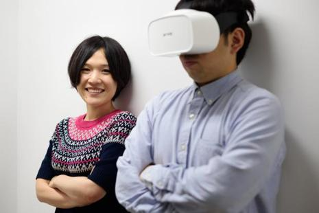Yuka Kojima, chief executive office of Fove Inc., left, poses for a photograph with a model wearing a Fove eye-tracking virtual reality (VR) headset in Tokyo on Tuesday. Photo: Bloomberg