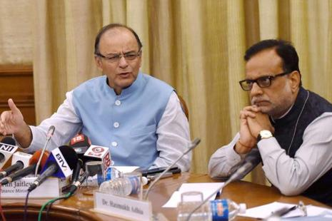 Union finance minister Arun Jaitley with revenue secretary Hasmukh Adhia addressing the media after the second GST council meeting on Friday. Photo: PTI