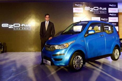 Mahindra Electric chief executive officer Arvind Mathew with the e2o plus. The electric car is priced between <span class='WebRupee'>Rs.</span>6.73 lakh and <span class='WebRupee'>Rs.</span>9.51 lakh (ex-showroom Bengaluru). Photo: PTI