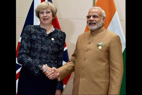 A file photo of Prime Minister Narendra Modi with UK Prime Minister Theresa May during a bilateral meeting at the G20 summit in Hangzhou, China. Photo: PTI
