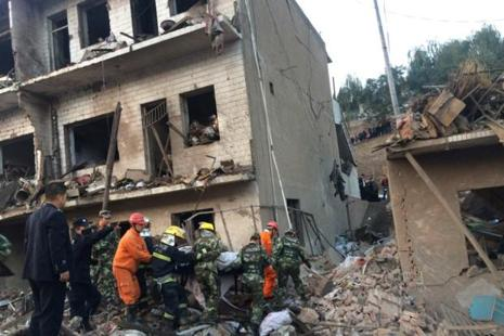 Rescue workers search at site after an explosion hit a town in Fugu county, Shaanxi province, China, on Monday. Photo: Reuters