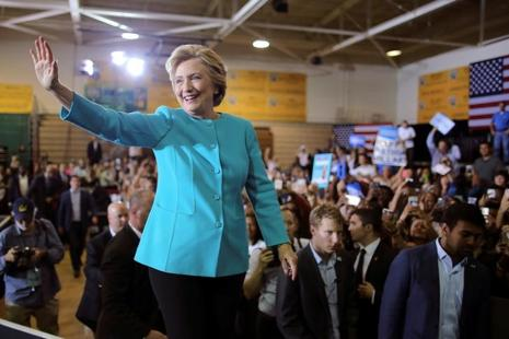 Hillary Clinton is scheduled to hold two rallies in Iowa on Friday to encourage her supporters to vote early and Bill Clinton heads to Ohio on Saturday for the first weekend of early voting there. Photo: Reuters