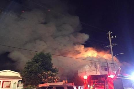 The converted two-story warehouse was used by artists as a living and work space but had no license for this, officials said, nor for the electronic dance party under way when the blaze broke out. Photo: Reuters