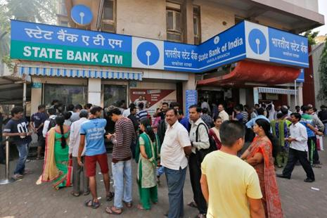 Deposits in 25.85 crore Jan Dhan accounts totalled Rs74,321.55 crore at the end of 30 November. Photo: Reuters