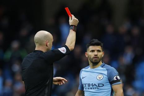 Manchester City's Sergio Aguero is shown a red card by referee Anthony Taylor. Photo: Reuters