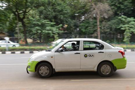 In November, Ola had said it would install tablets in its cabs through which customers can access personalized content such as music, movies, shopping, and also control the air-conditioning. Photo: Mint