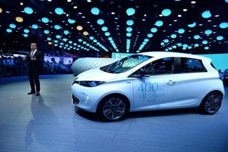 A file photo of French carmaker Renault CEO Carlos Ghosn in front of an electric car Zoe. Photo: AFP